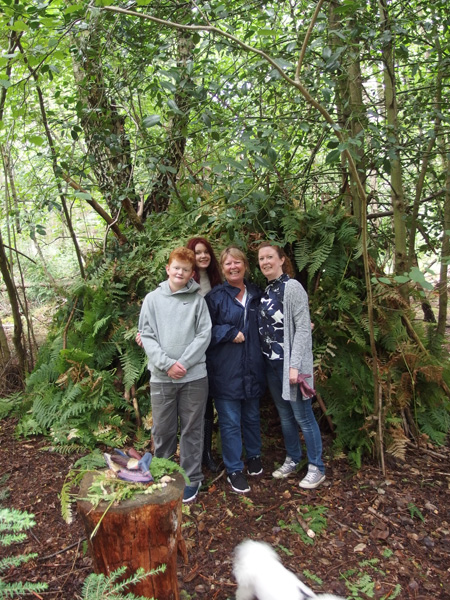 woodland den with people